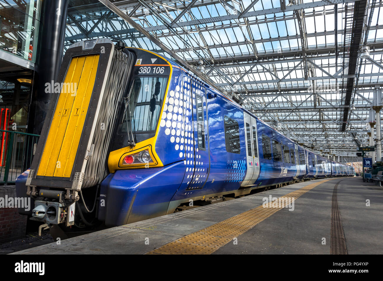 ScotRail Class 380 Desiro passenger train waiting at a station in the UK. Stock Photo