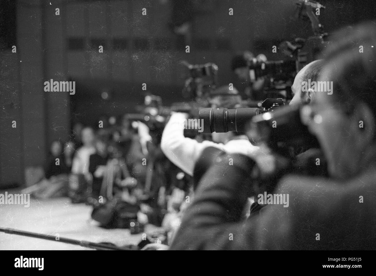 Photographers and film crews during a press conference with Dany Nemcova (co-signatory of Charter 77), Jiri Dienstbier (later Czech Foreign Minister) and Vaclav Maly (later Auxiliary Bishop of Prague). Stock Photo