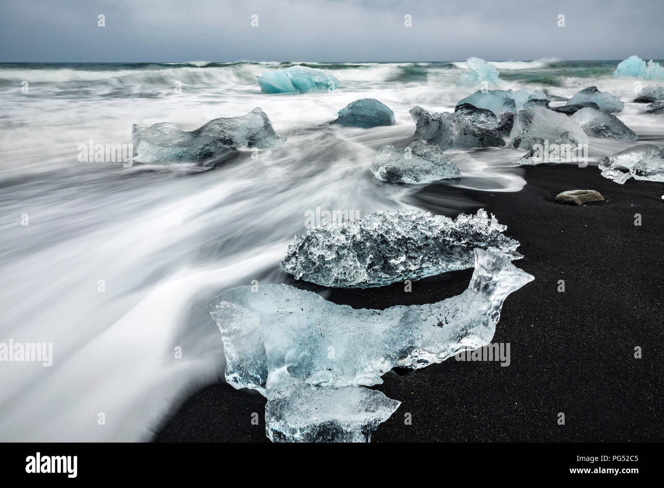 Iceblocks at the black sand beach, Jokulsarlon glacier - Stock Image