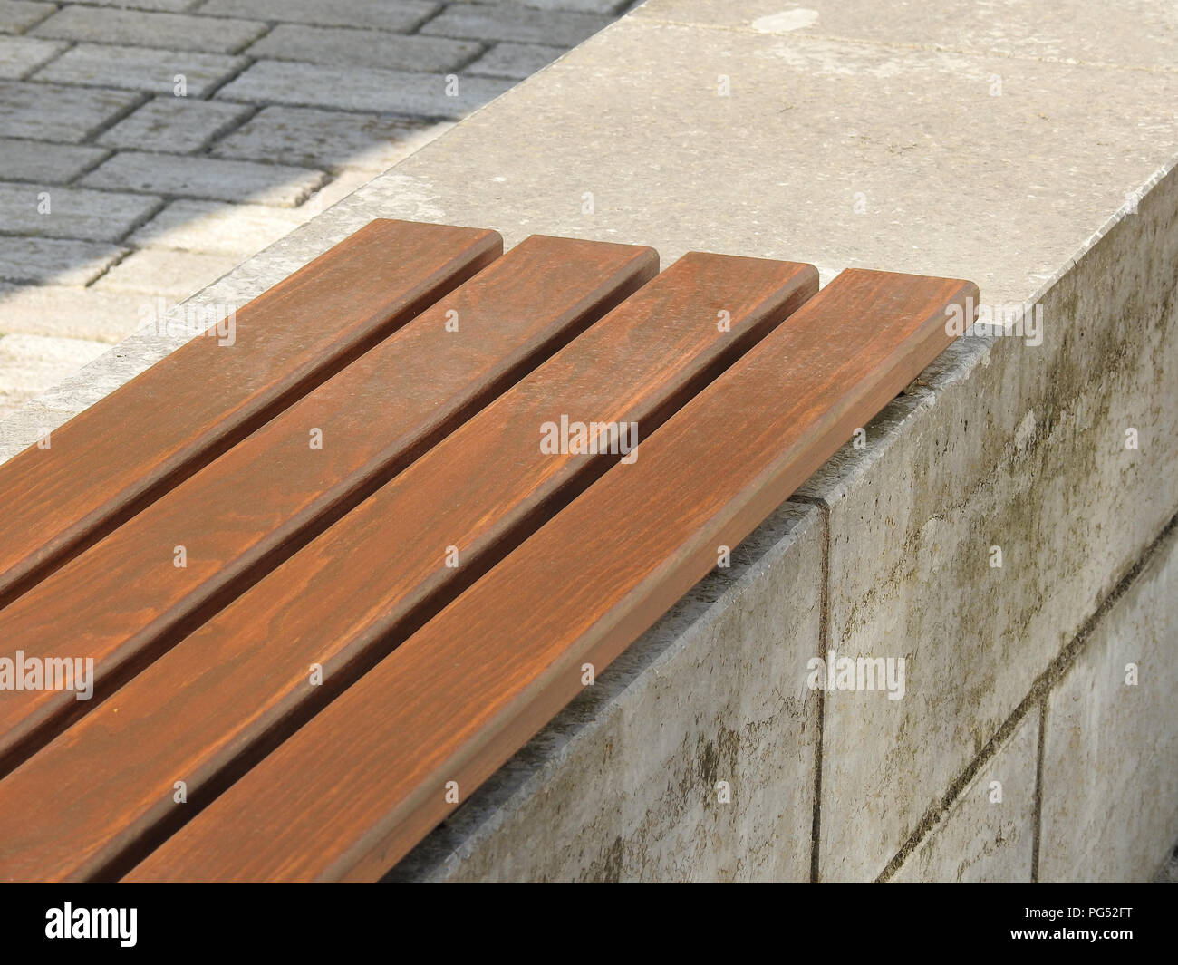 Part of a wooden bench - Stock Image