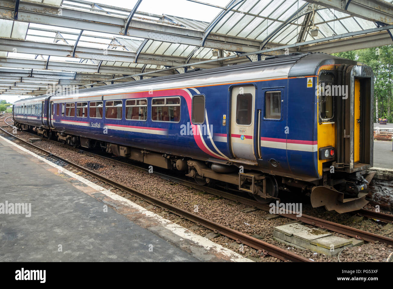A ScotRail Class 156 'Super Sprinter' train, stationary at a platform in Kilmarnock Railway Station in East Ayrshire, Scotland. - Stock Image