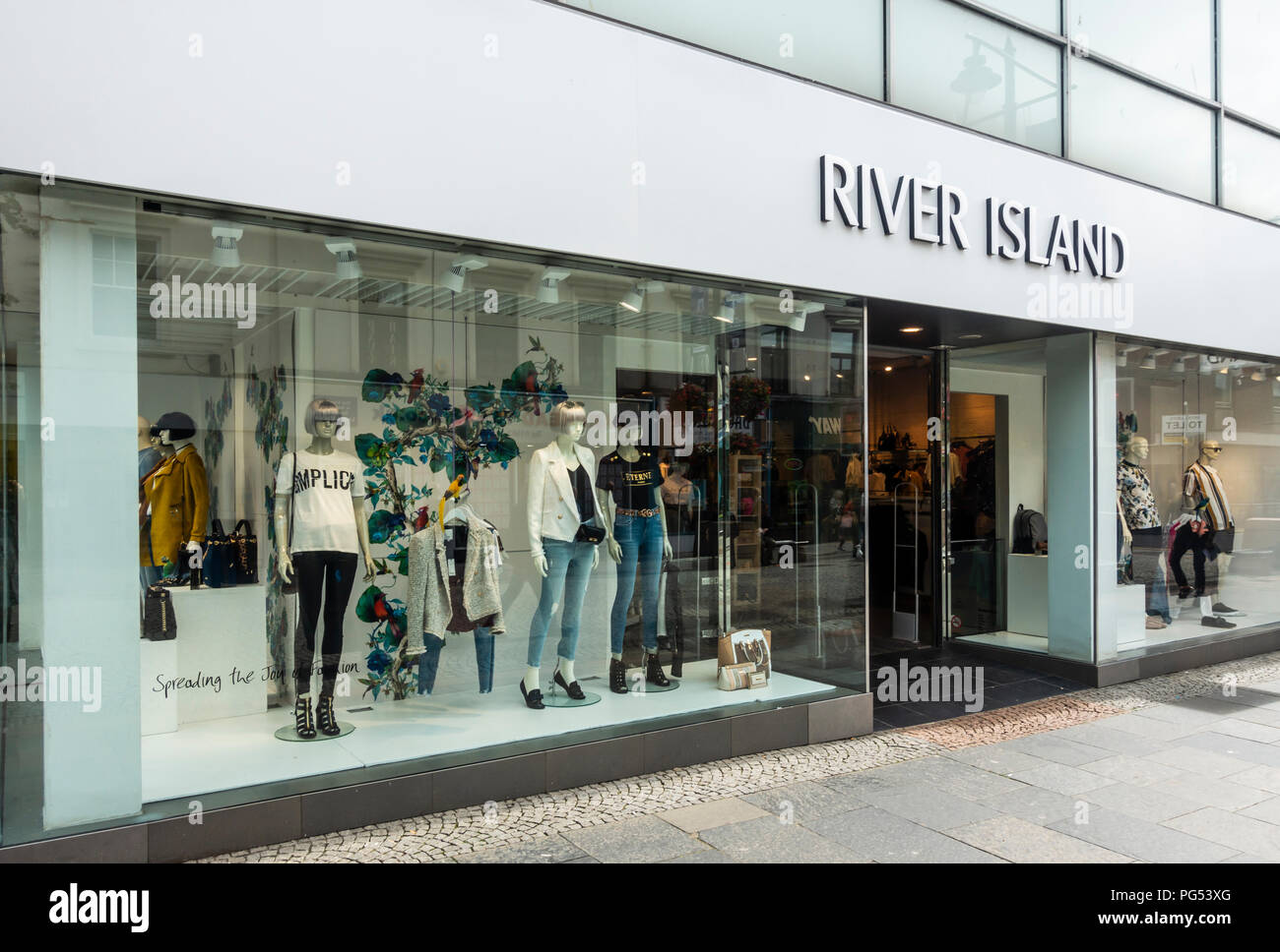 Shop windows with mannequins & clothes and entrance of the River Island fashion store in Kilmarnock, East Ayrshire, Scotland. - Stock Image