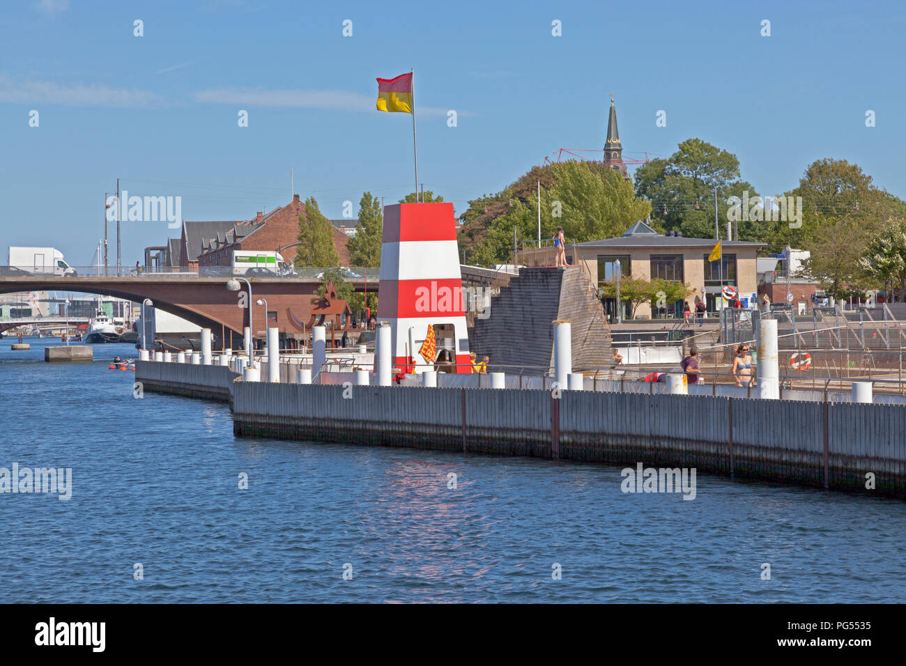 The Copenhagen Harbour Bath at Islands Brygge in the inner harbour of Copenhagen on a warm and  sunny summer day seen from the main harbour canal. Stock Photo
