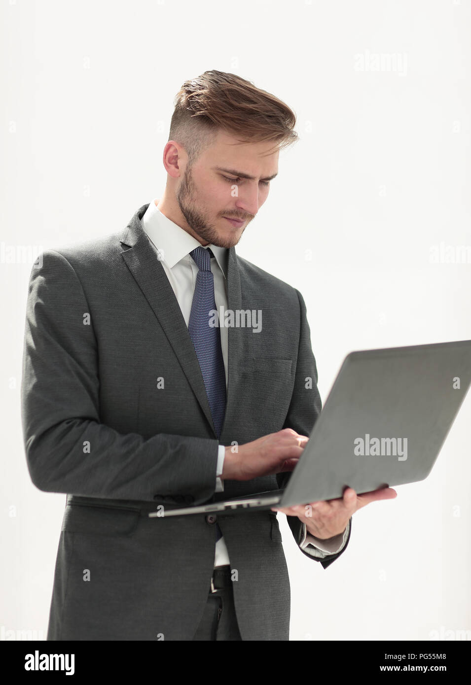 close up.businessman examines a new laptop. - Stock Image