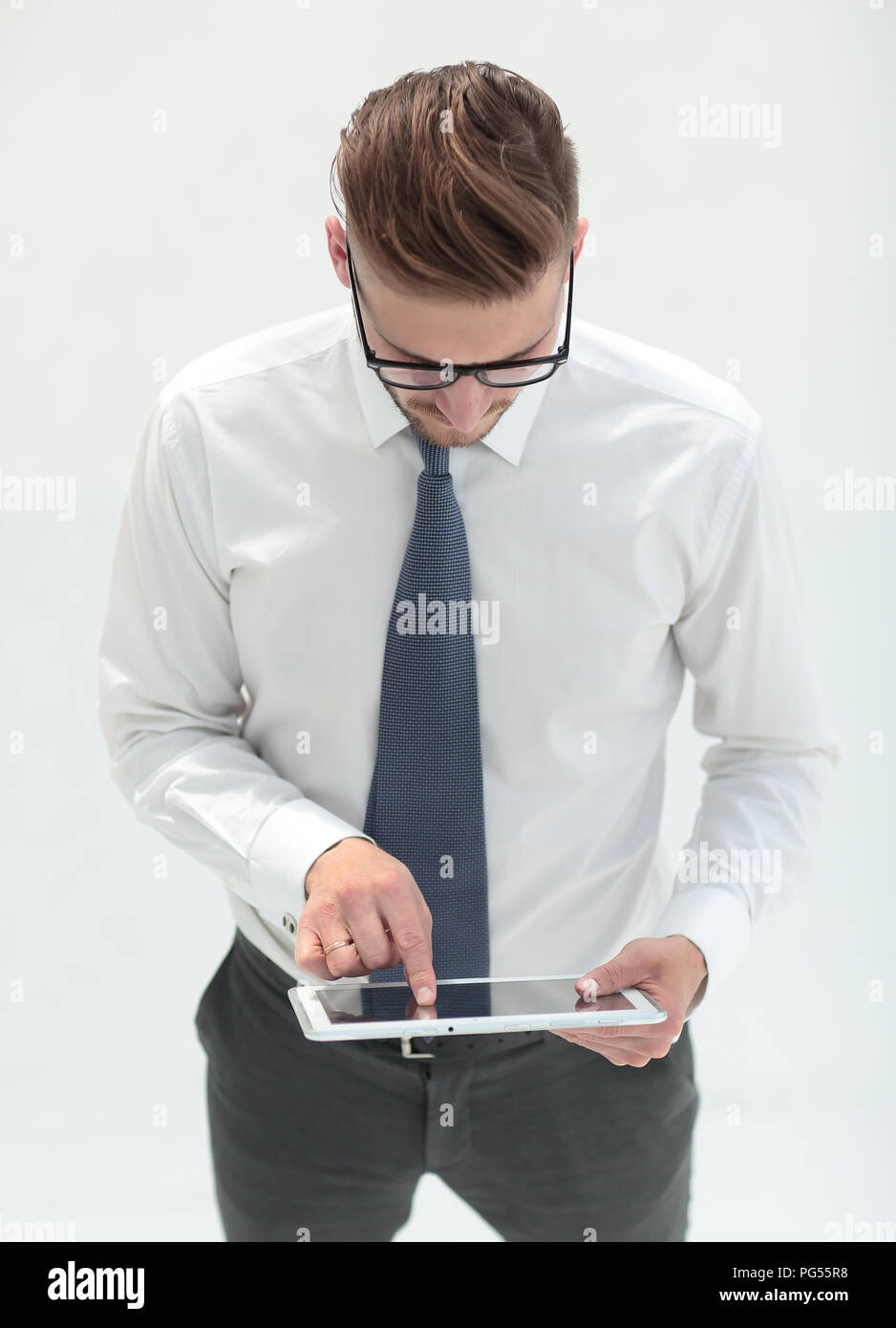 close up.modern business man by tapping the screen of digital tablet - Stock Image