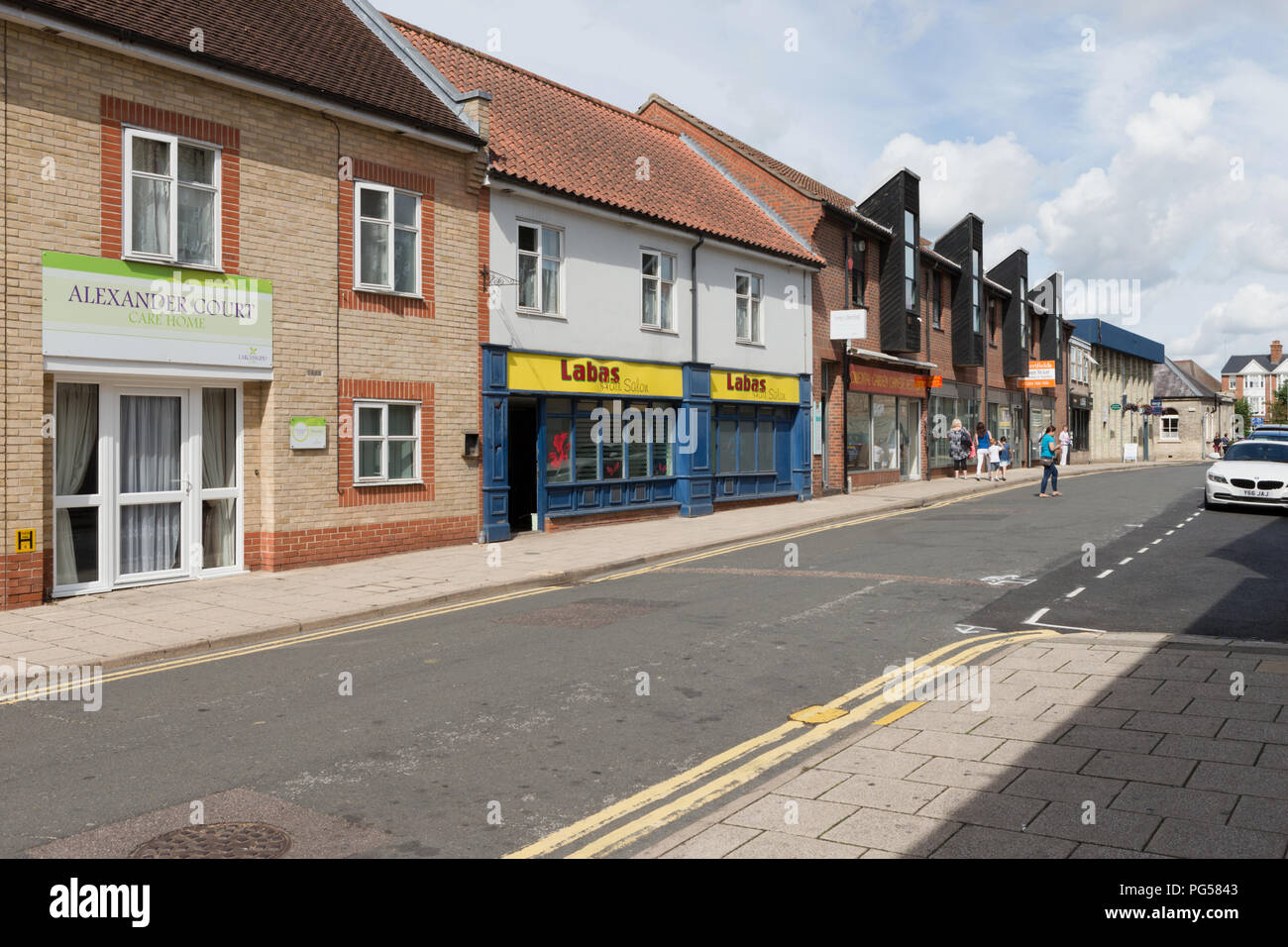 Alexander Court, shops and businesses in Guildhall Street, Thetford. Unsharpened - Stock Image