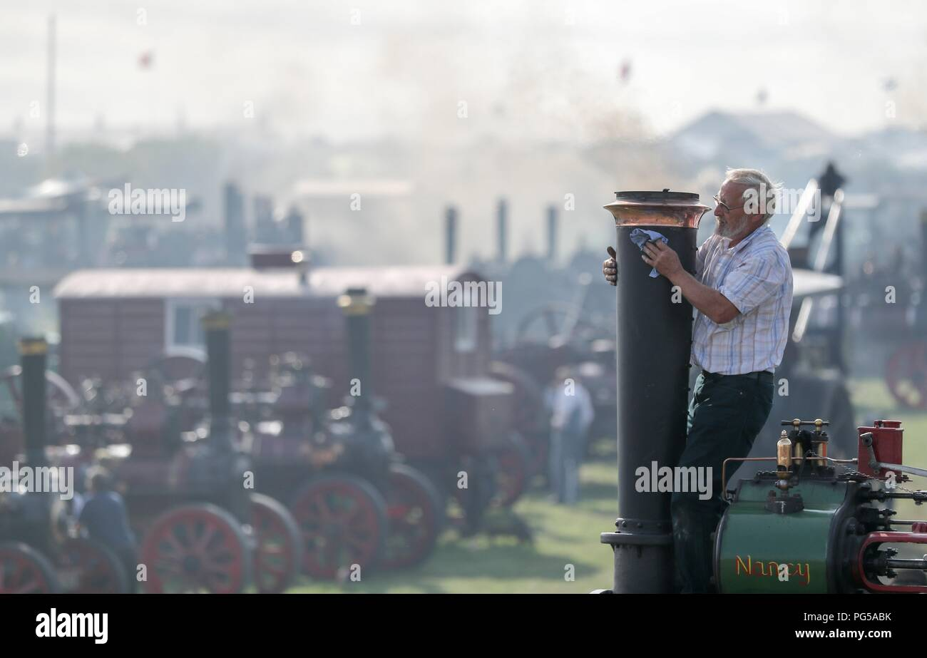 c9e57b18d5b Jeff Goodhall polishes the chimney of an Aveling & Porter AR7 convertible  general purpose engine at the Great Dorset Steam Fair, at Tarrant Hinton,  ...