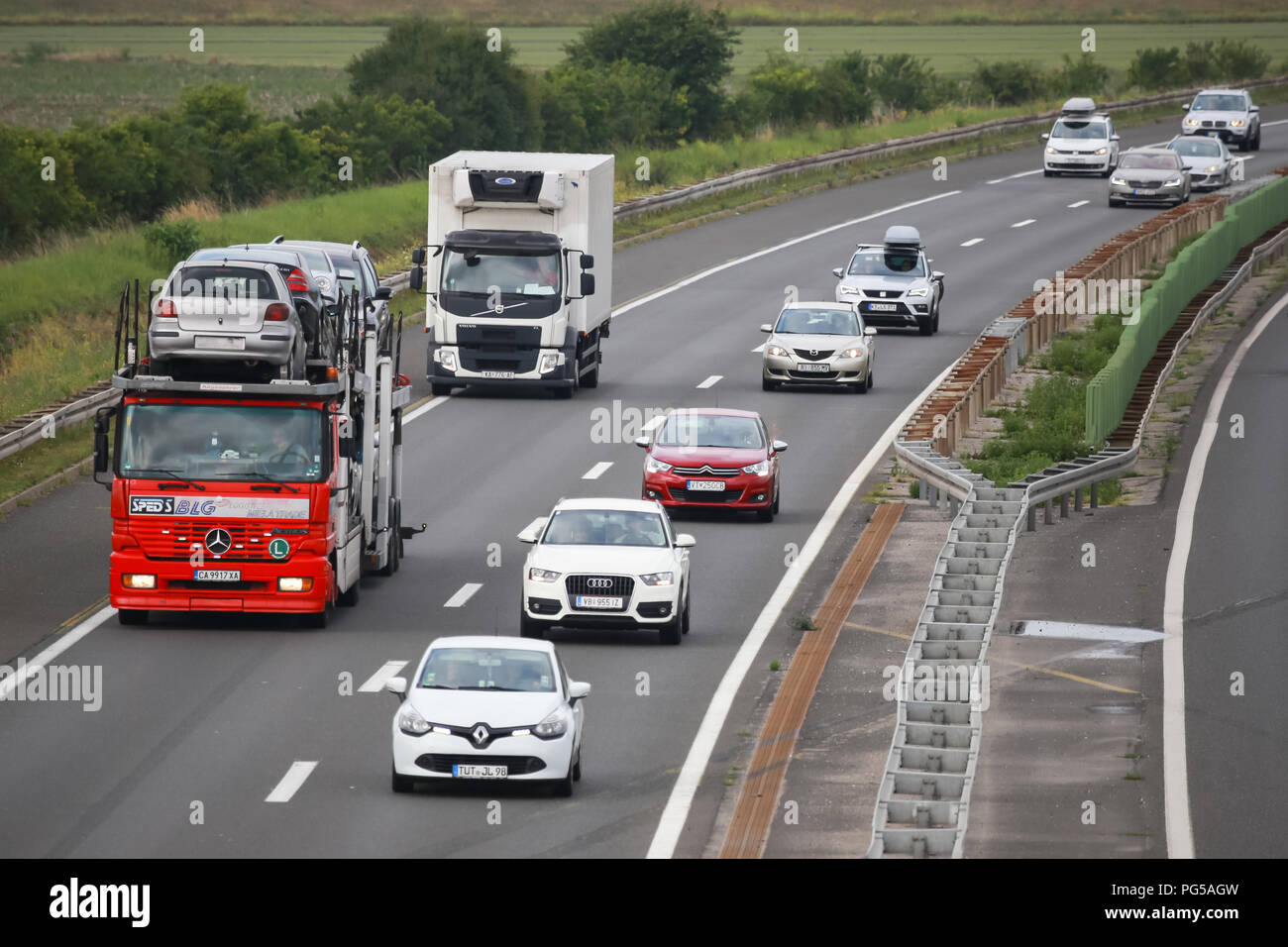 Zagreb, Croatia - August 11th, 2018 : Car transport truck filled up with used cars driving on Zagreb motor way bypass in Zagreb, Croatia. Stock Photo