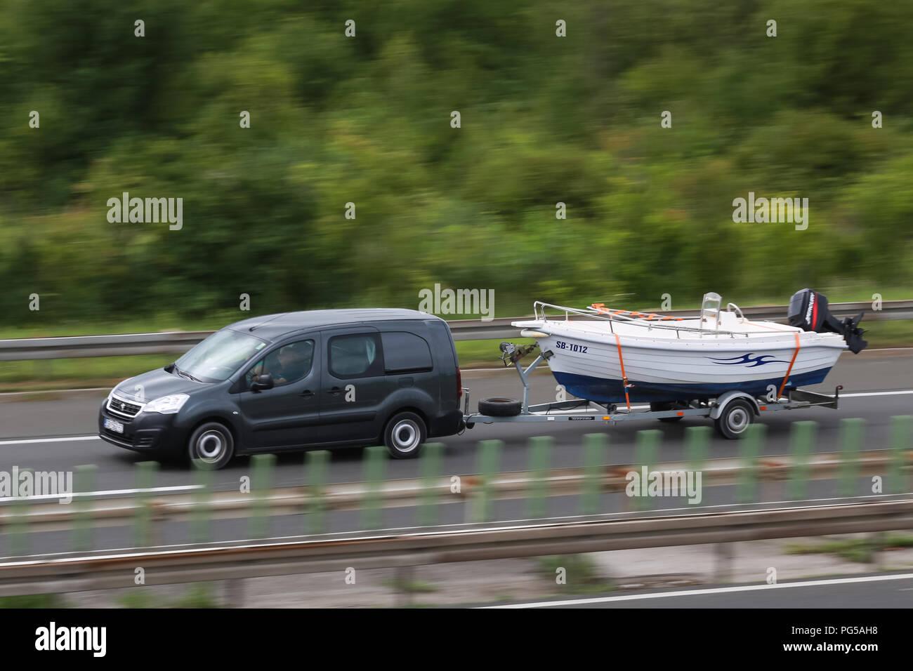 Zagreb, Croatia - August 11th, 2018 : Close up of speeding car on the Zagreb motor way bypass in Zagreb, Croatia. Stock Photo