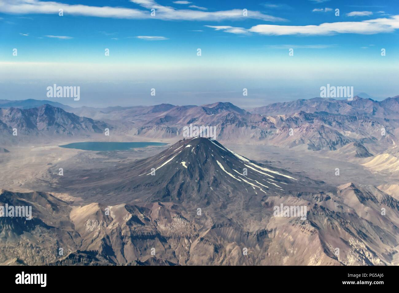Overflying the 'Maipo' vulcano on our way from Chile to Argentina. - Stock Image