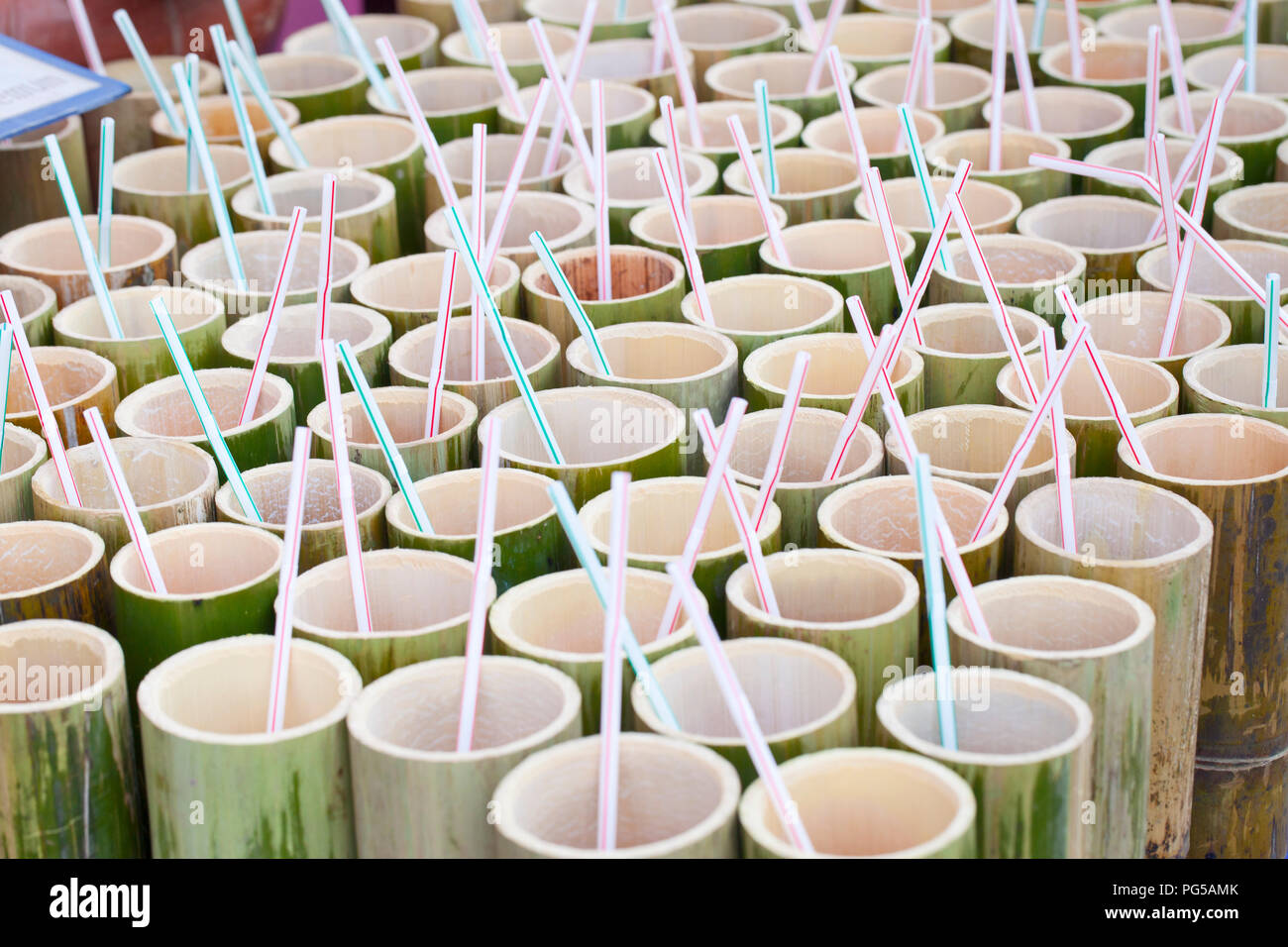Bamboo cups waiting to be filled, Thailand - Stock Image