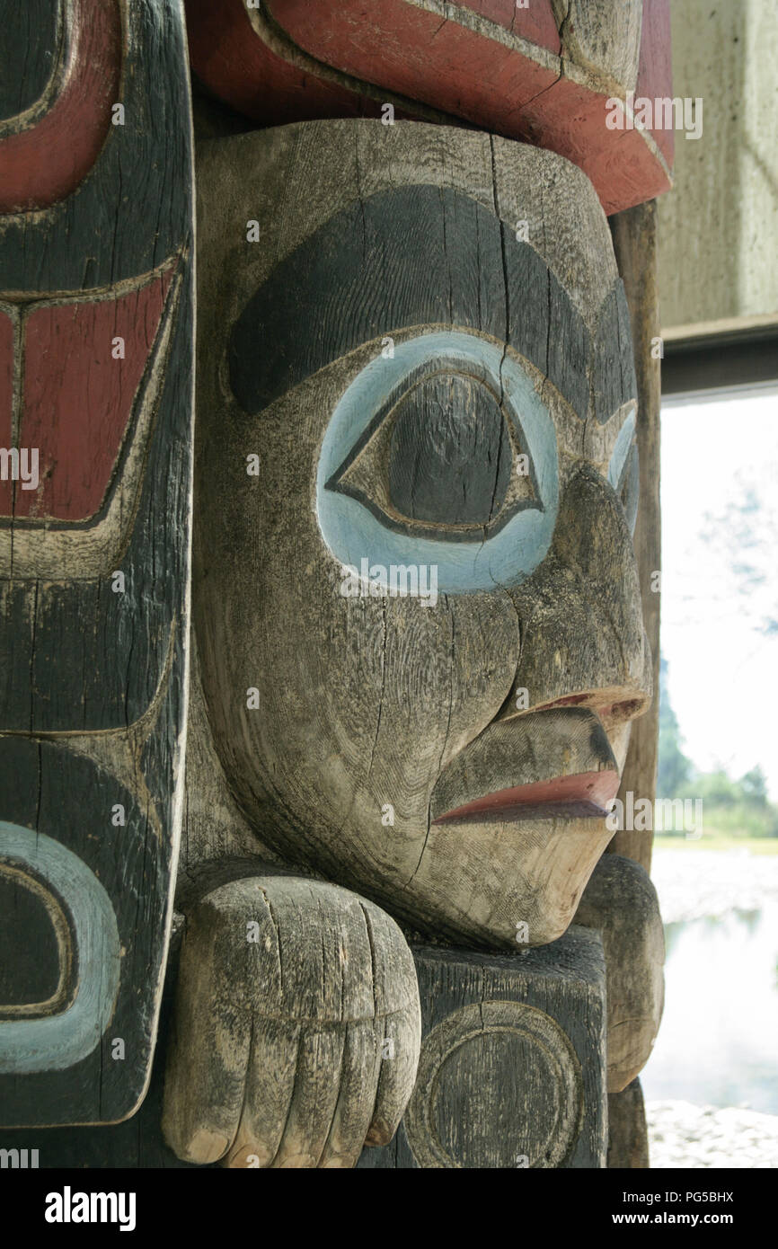 Close up of a face on a totem pole in Vancouver, Canada - Stock Image