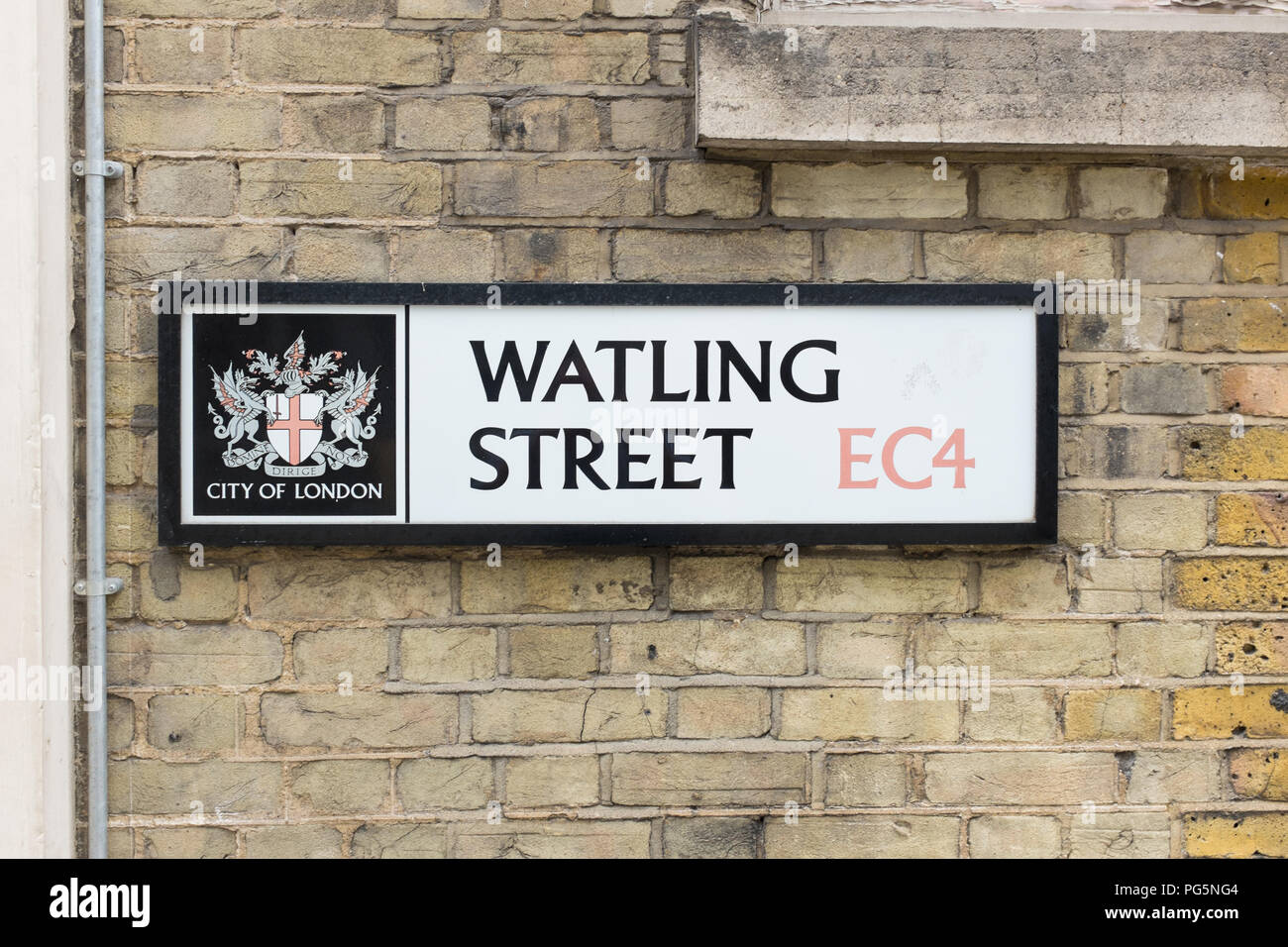 Traditional street sign for Watling Street in the City of London mounted on a wall made of London bricks - Stock Image