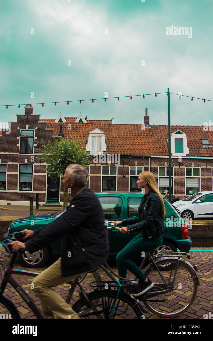 Bikes and tourists in Amsterdam (Netherlands) - Stock Image