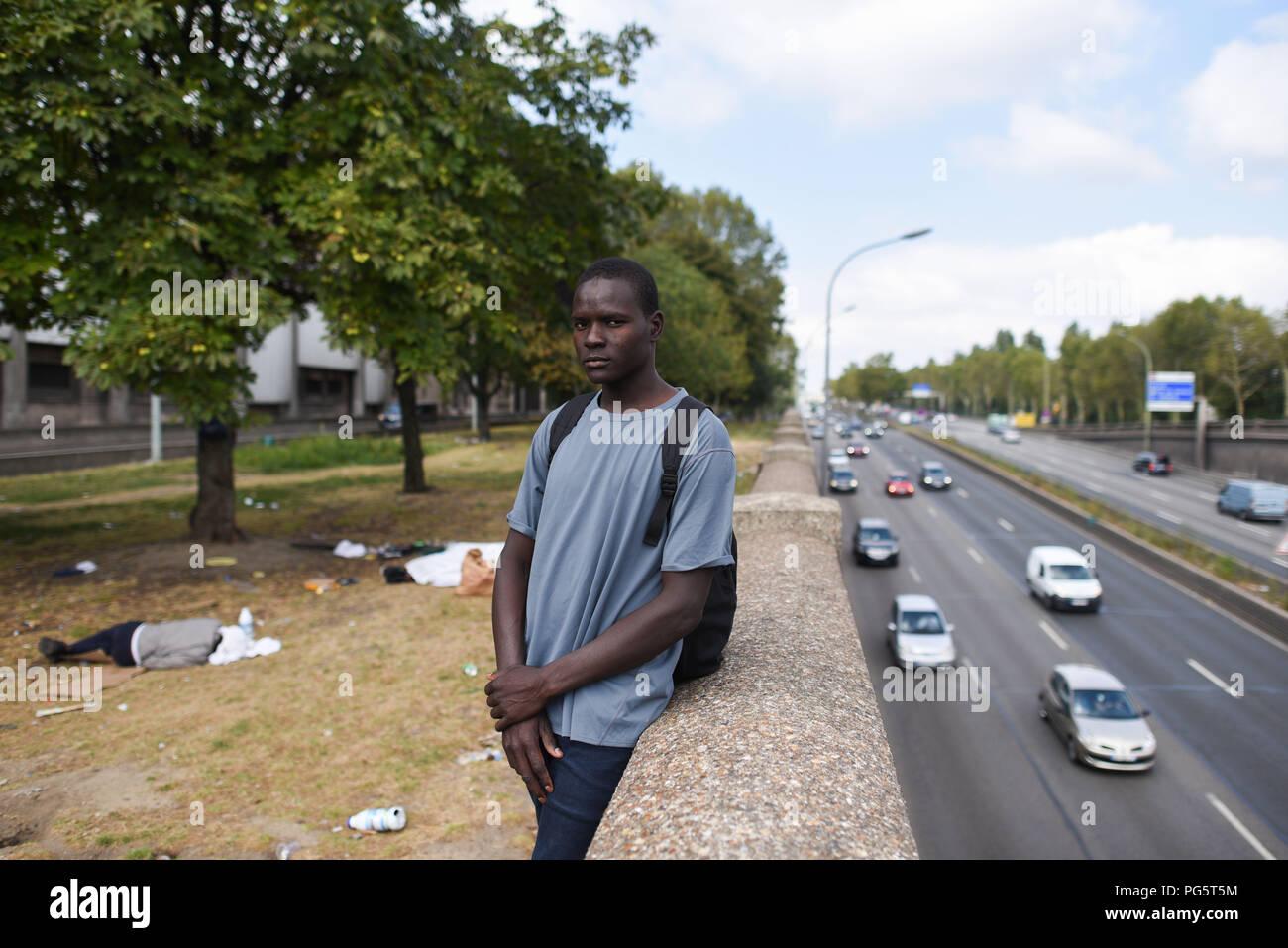 August 14, 2018 - Paris, France: Portrait of a 16-year-old Chadian migrant who sleeps in a public park near the peripherique (ring road) between porte de la Chapelle and porte d'Aubervilliers. Portrait de Samadjita, un migrant tchadien de 16 ans, arrive a Paris depuis environ une semaine. Le jeune mineur, originaire de la region du Lac Tchad ou les jihadistes de Boko Haram sement la terreur, dort dans un parc public a proximite du peripherique entre porte de la Chapelle et porte dÕAubervilliers. *** FRANCE OUT / NO SALES TO FRENCH MEDIA *** - Stock Image