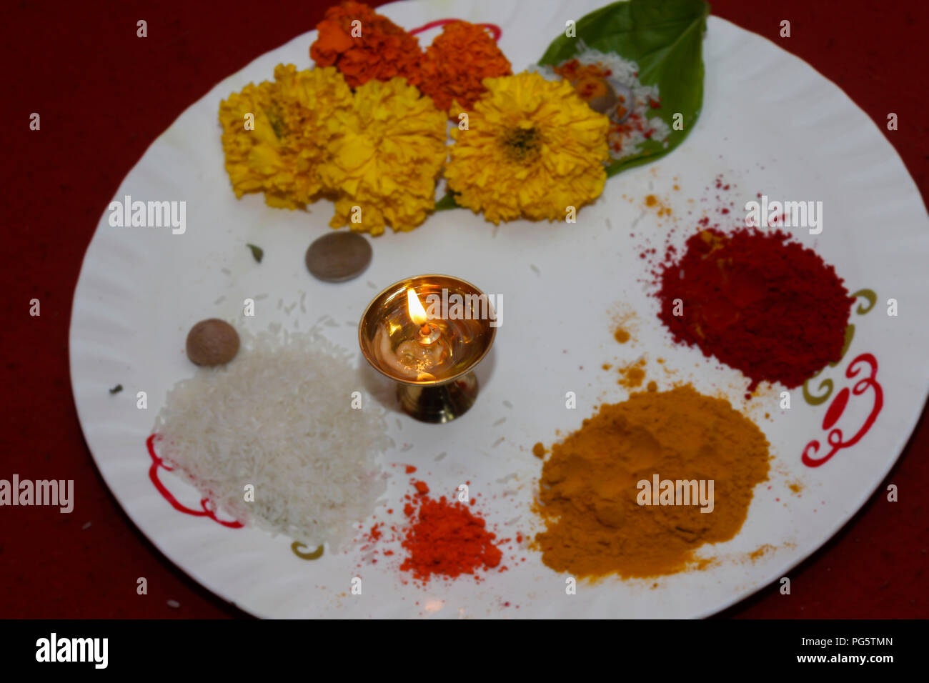 a plate ready for hindu god prayer with different essential things in a occasion of wedding - Stock Image
