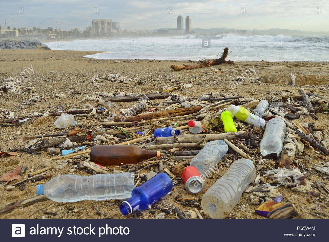 Marine debris plastic rubbish washed up on Barcelona beach in Spain Europe. - Stock Image