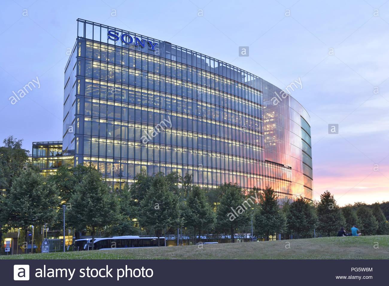 Modern Sony center building, glazed facade illuminated at dusk. Potsdamer Platz Berlin Germany Europe. - Stock Image