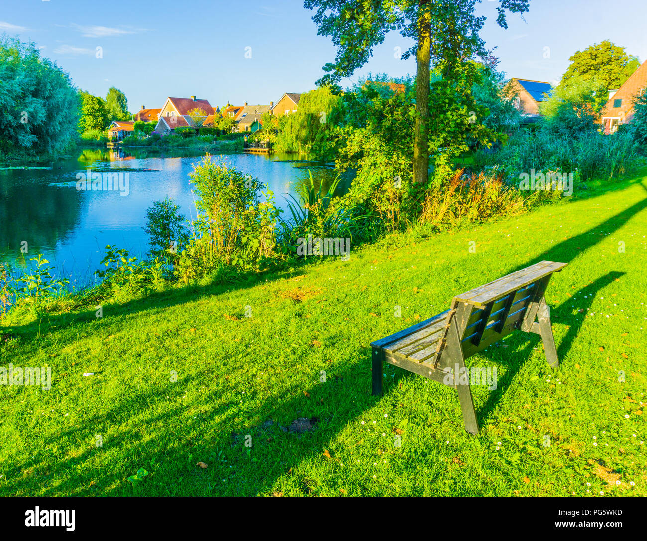 Phenomenal Small Wooden Bench In A Beautiful Park With Lake Landscape Bralicious Painted Fabric Chair Ideas Braliciousco