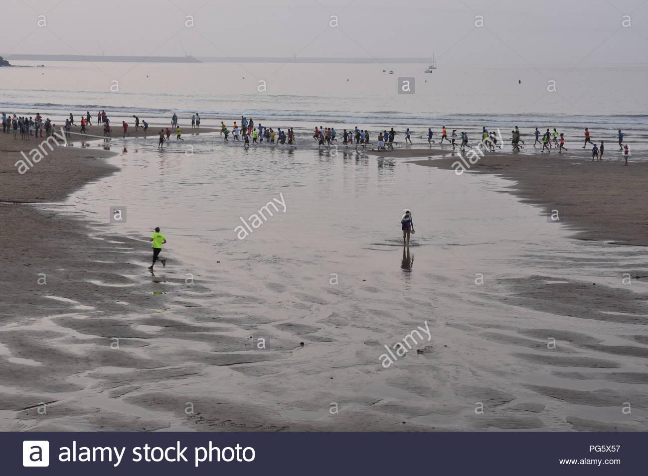 People leisure activities misty Atlantic coast. Gijon Asturias Northern Spain Europe. - Stock Image