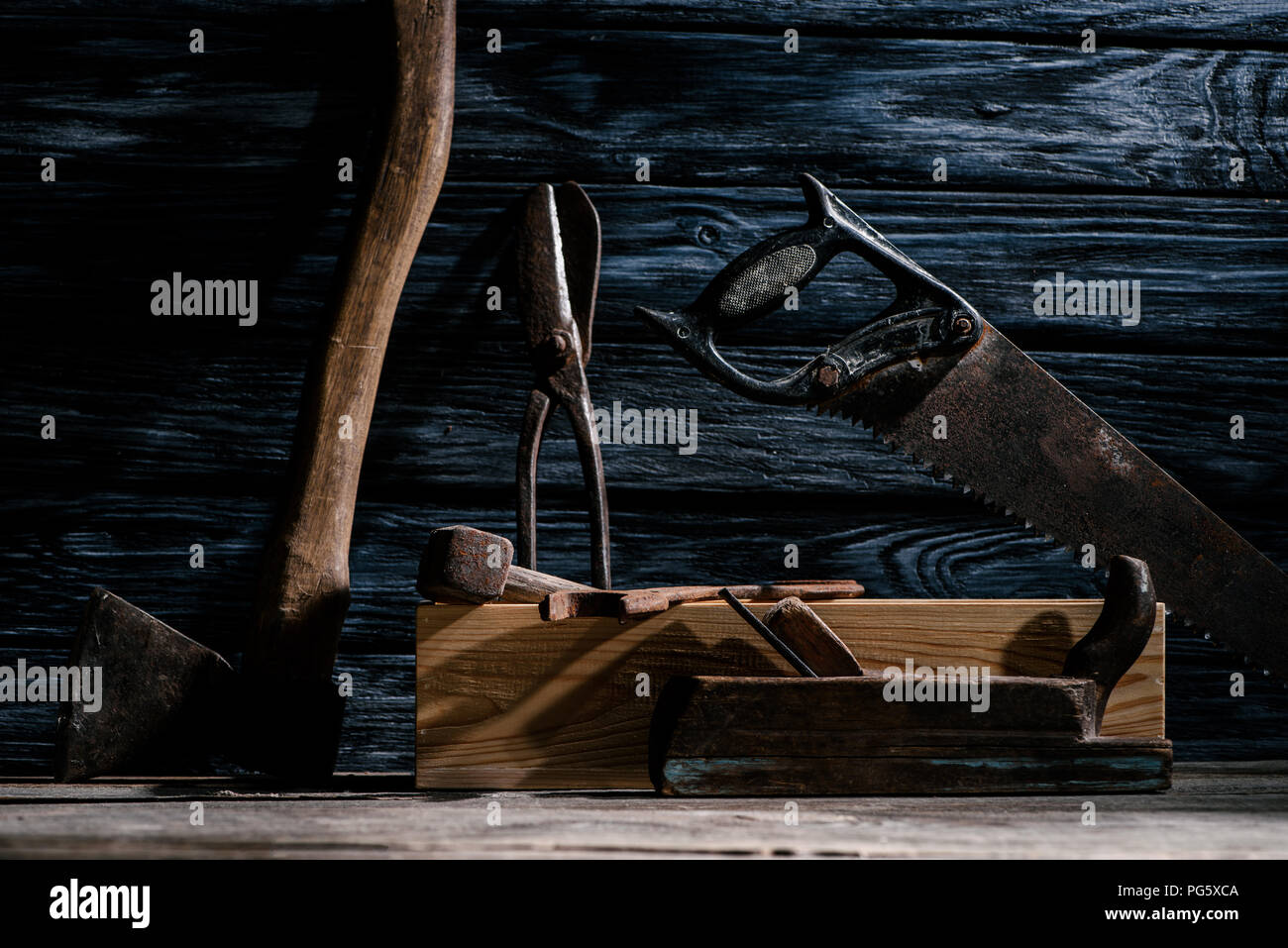 close up view of vintage carpentry tools arranged on wooden tabletop - Stock Image