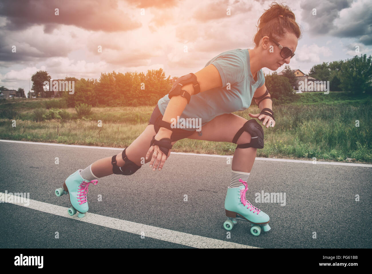 Woman In A Vintage Roller Skates Retro Quad Roller Skates Riding Outdoors Stock Photo Alamy