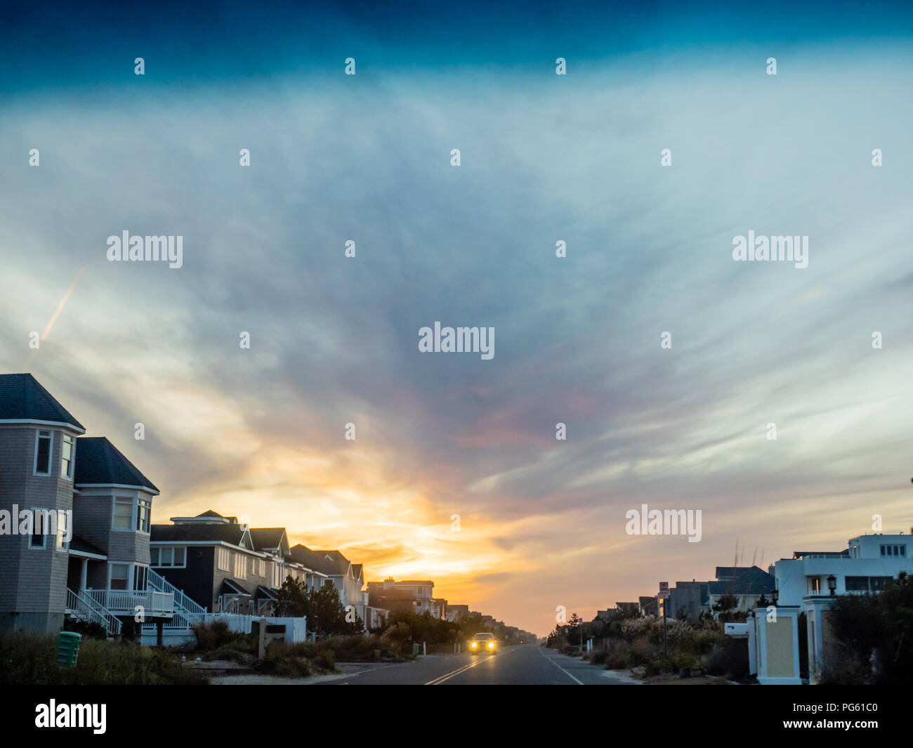View of homes at sunset on Dune Road, Westhampton, the Hamptons, Long Island, New York, USA. - Stock Image