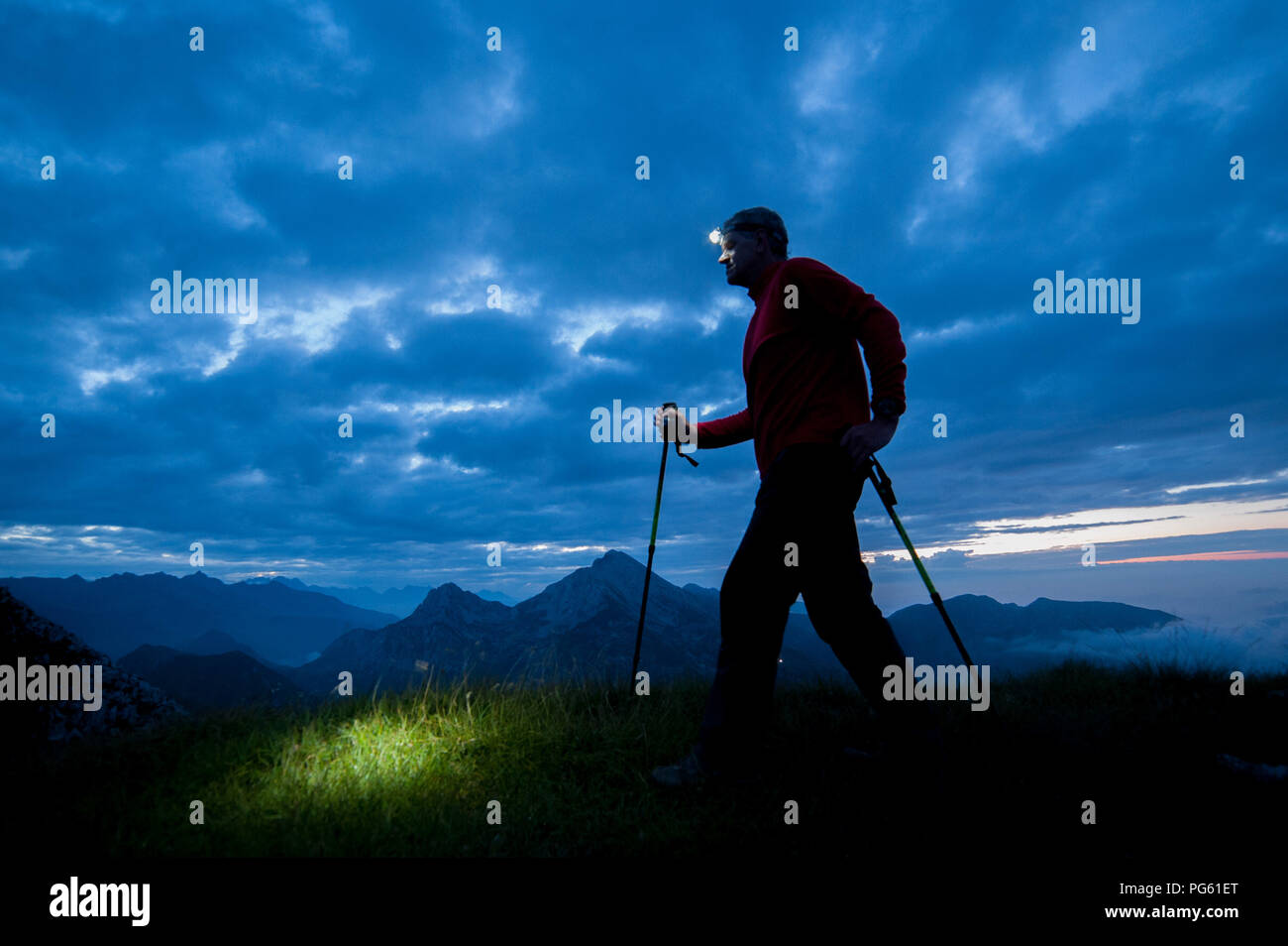 walk in the mountains with an early morning electric torch Stock Photo