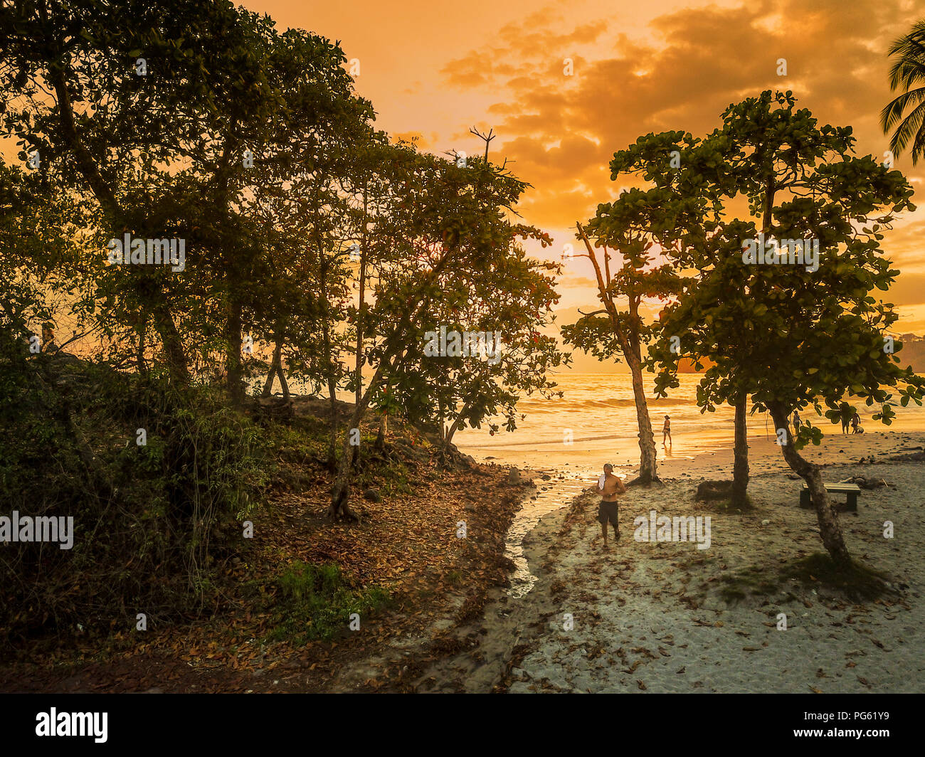People enjoying the Sunset on the Beach, Corcovado National Park, Osa Peninsula, Costa Rica. This image is shot using a drone. - Stock Image