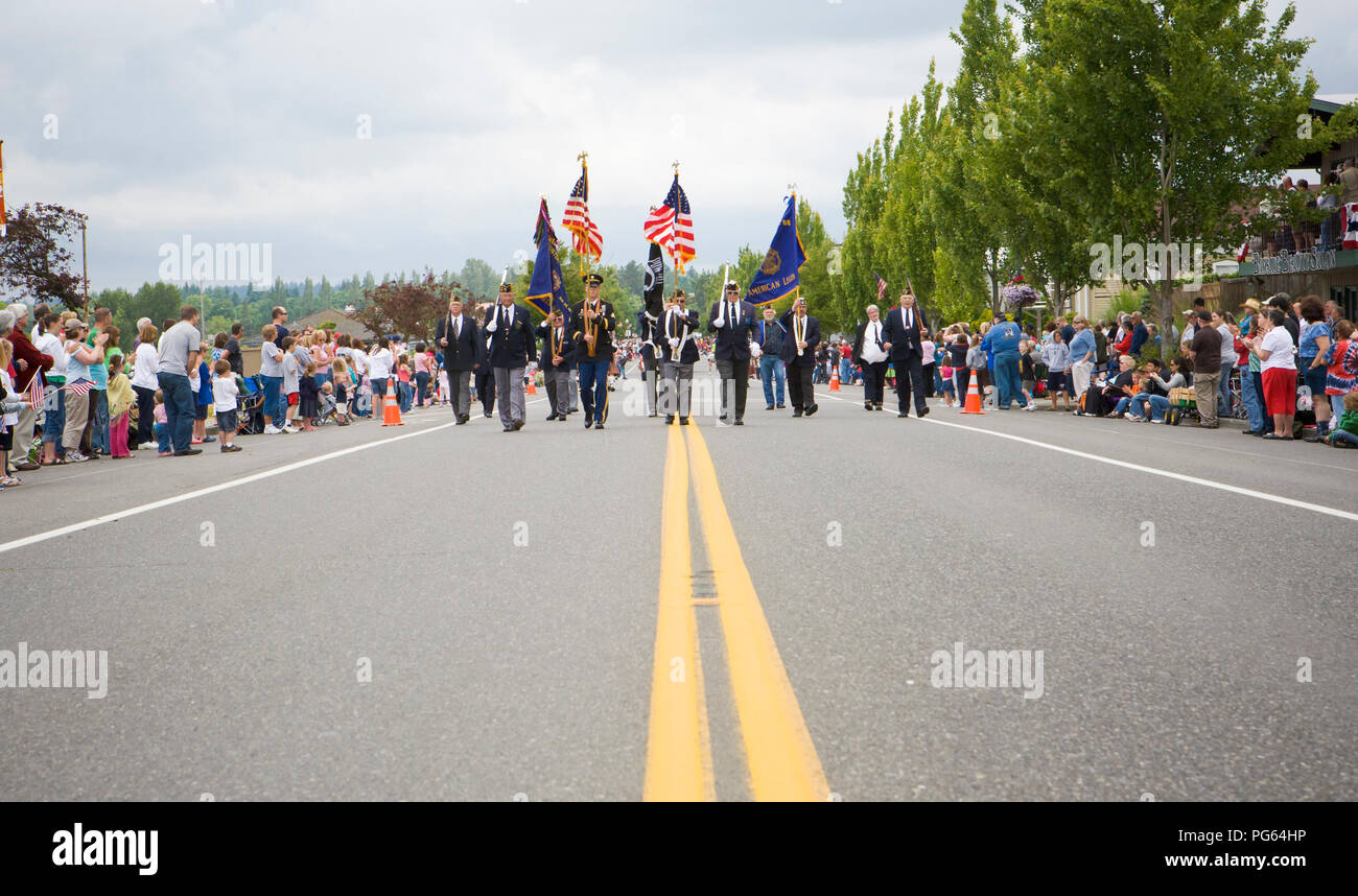 A military color guard starting off an Independence Day parade in Blaine, WA 2008. - Stock Image