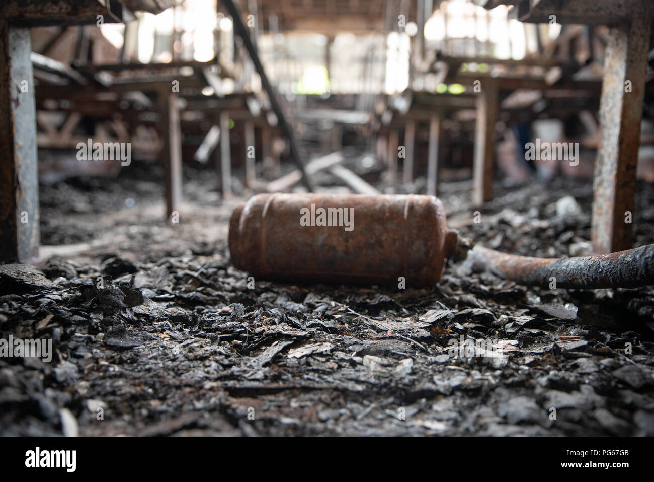 Burned down bus, inside. After a fire. Conception - is fire safety - Stock Image