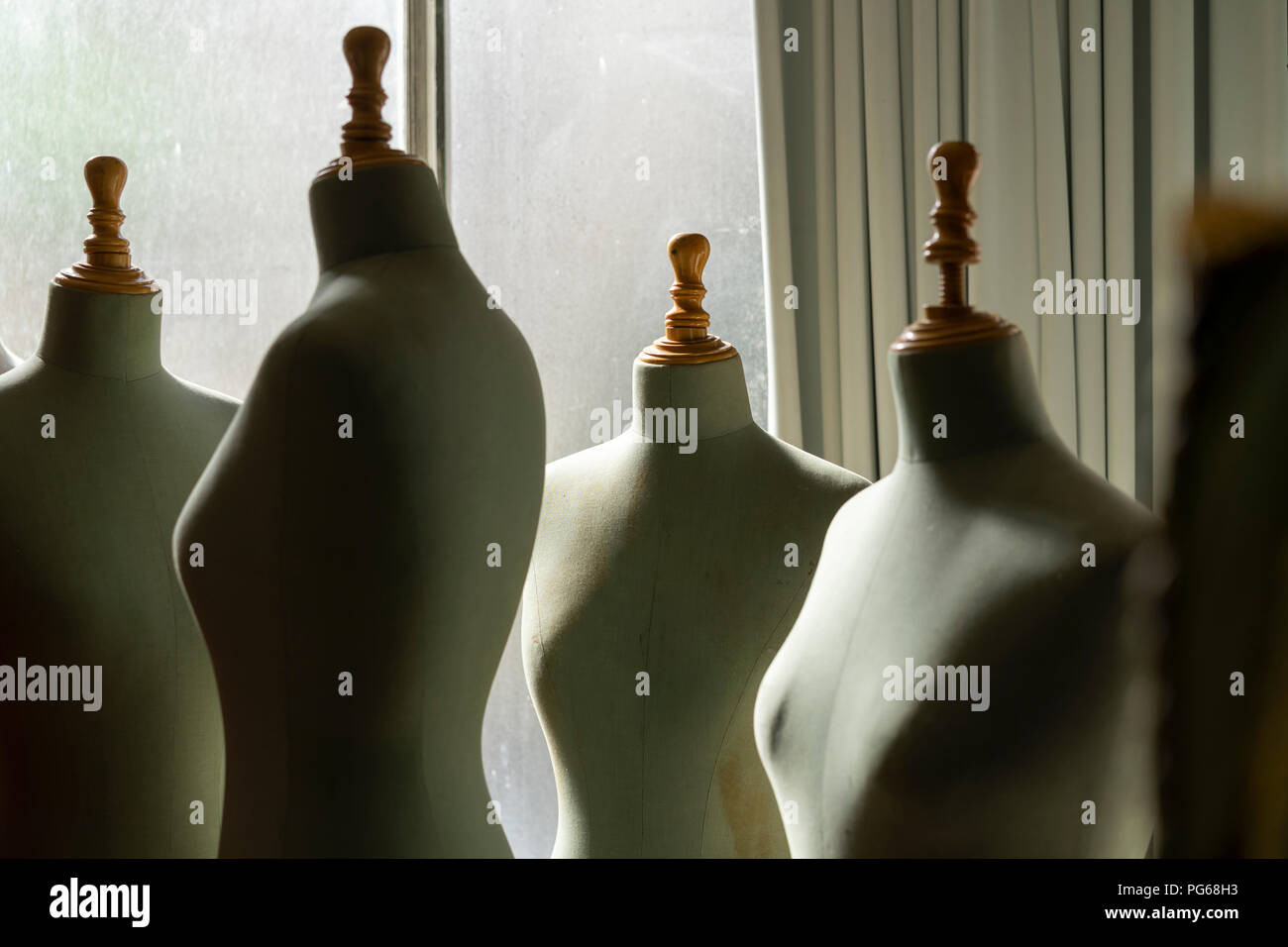 Dressmaker's models in fashion designer's studio - Stock Image