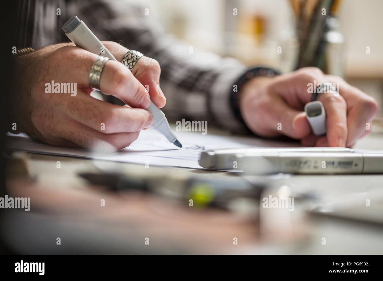 Close-up of artist drawing a sketch - Stock Image