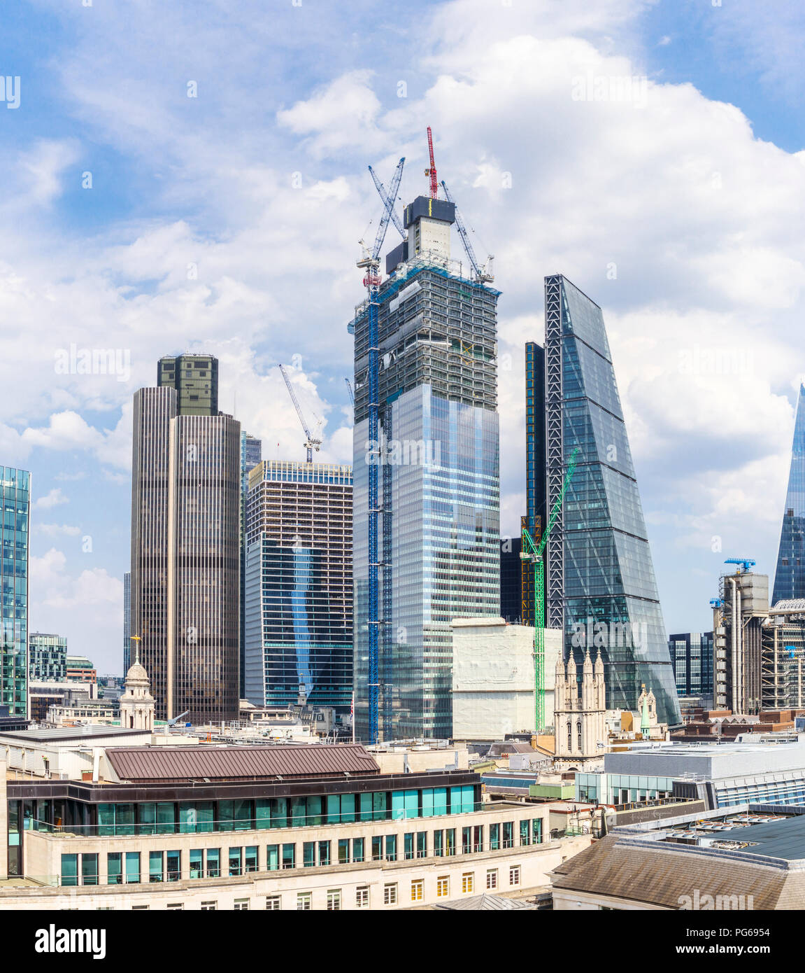 City of London changing skyline: 22 and 100 Bishopsgate under construction between Tower 42 and the Cheesegrater, financial and insurance district Stock Photo