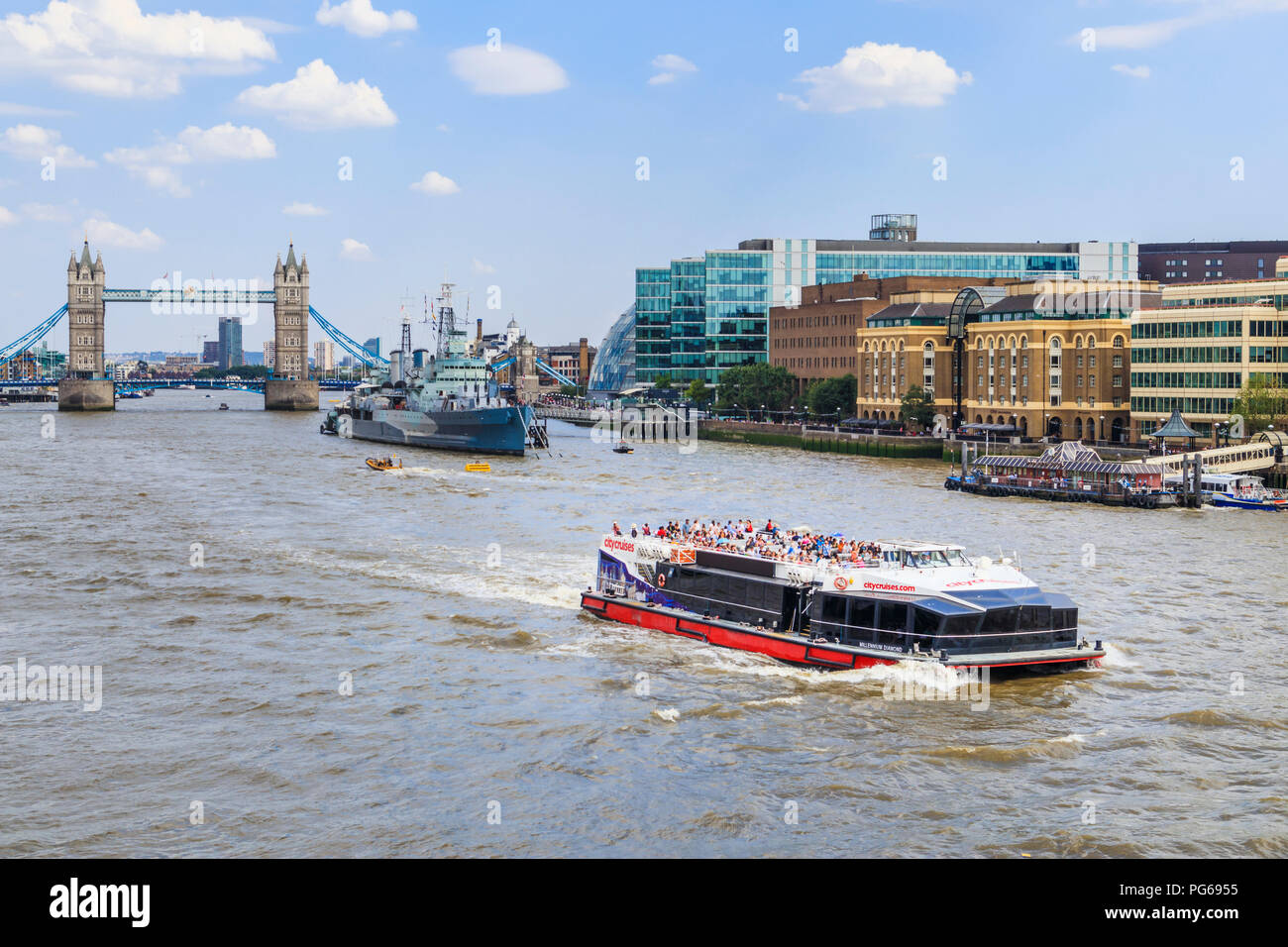 City Cruise riverboat sailing on the River Thames in the Pool of London on a popular tourist sightseeing cruise in summer viewed from London Bridge - Stock Image