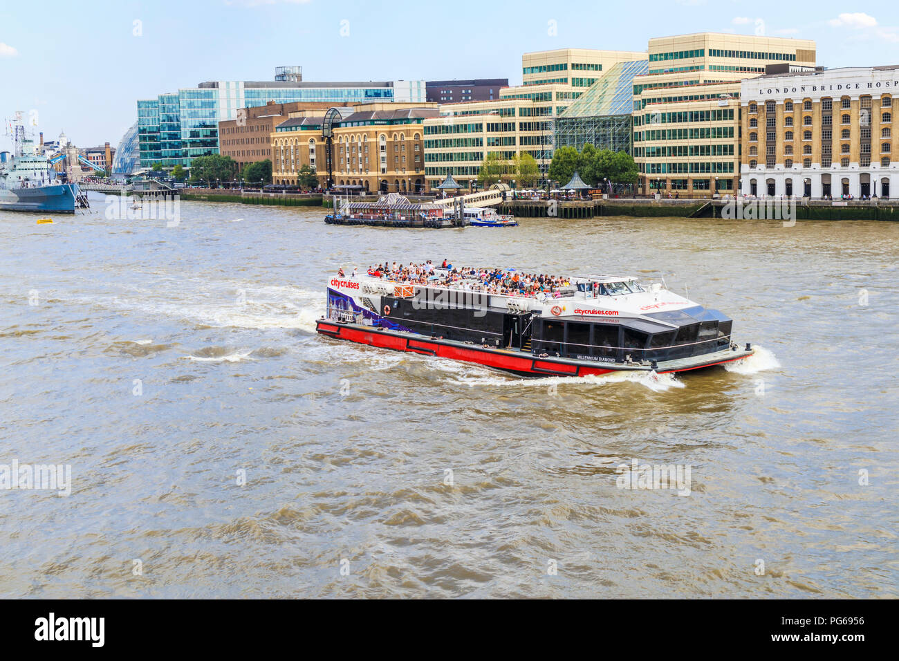 City Cruise riverboat sailing on the River Thames in the Pool of London on a popular tourist sightseeing cruise in summer viewed from London Bridge Stock Photo