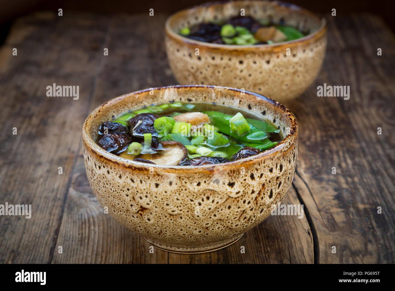 Japanese miso soup with sugar peas, shitake mushrooms, tofu and mung sprouts - Stock Image