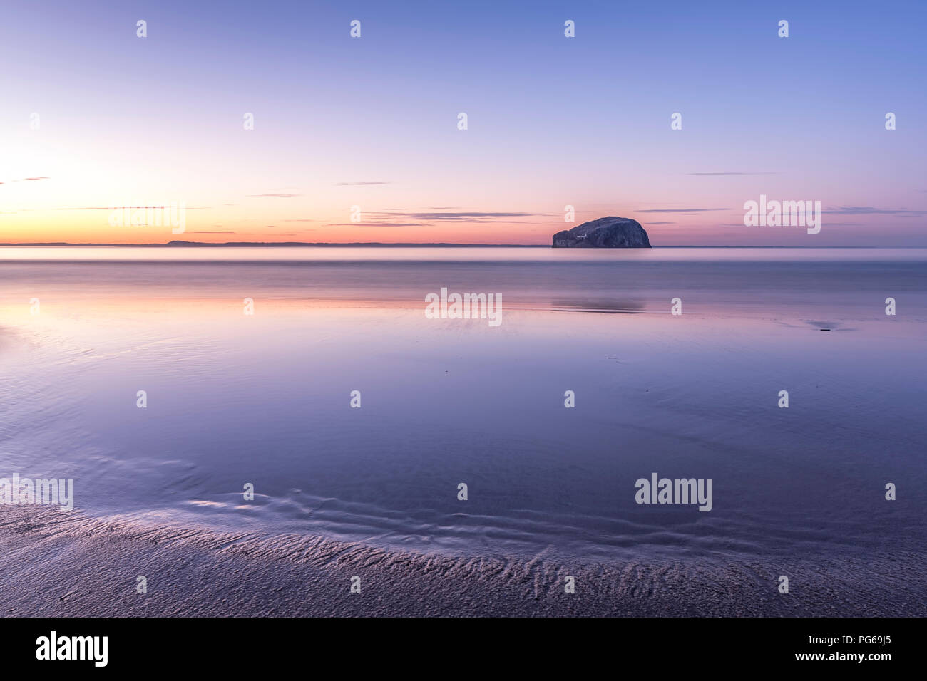 UK, Scotland, East Lothian, North Berwick, Firth of Forth, view of Bass Rock (world famous Gannet Colony) at sunset, Lighthouse, long exposure Stock Photo