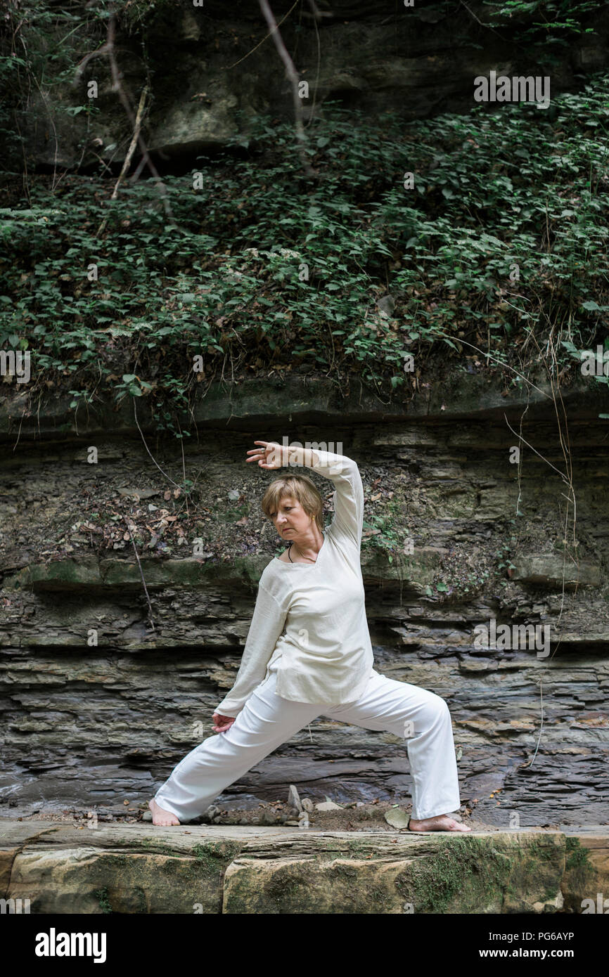 Senior woman doing yoga - Stock Image