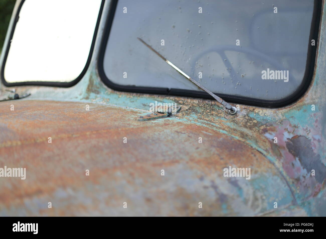 A Windshield of old vintage classic car wreck - Stock Image