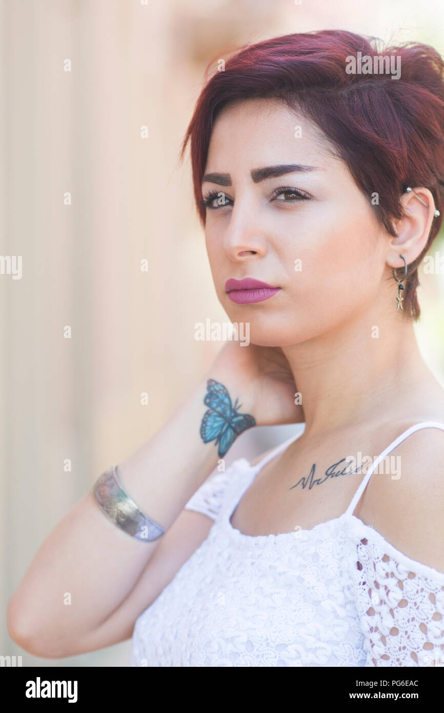 Beautiful Young Woman With Butterfly Tattoo On Wrist Hand Touching Neck Outdoors Stock Photo Alamy