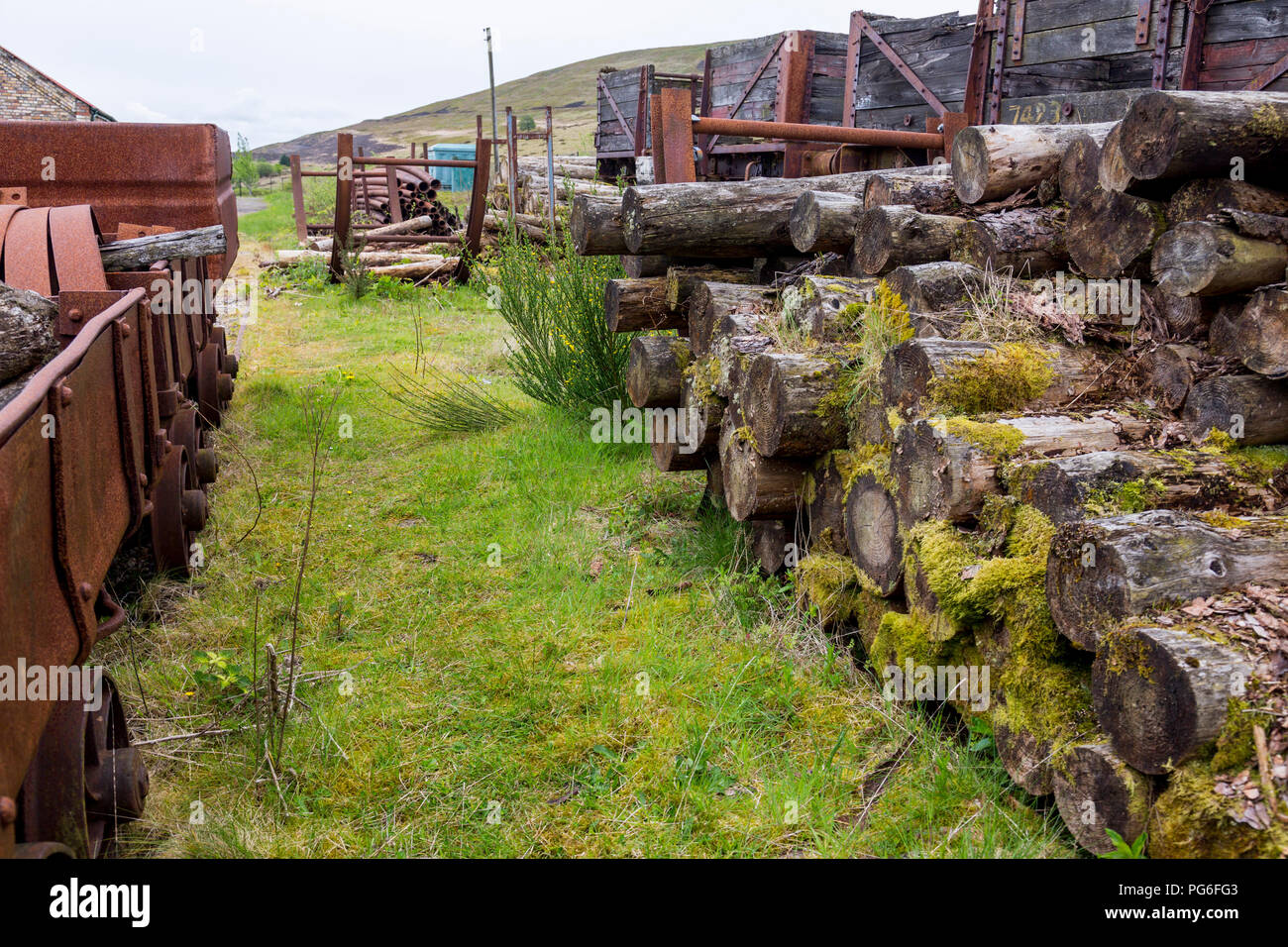 Rotting wooden railway wagons and pit props once used at Big Pit - a former coal mine now a UNESCO World Heritage Site in Blaenavon, Gwent, Wales, UK - Stock Image