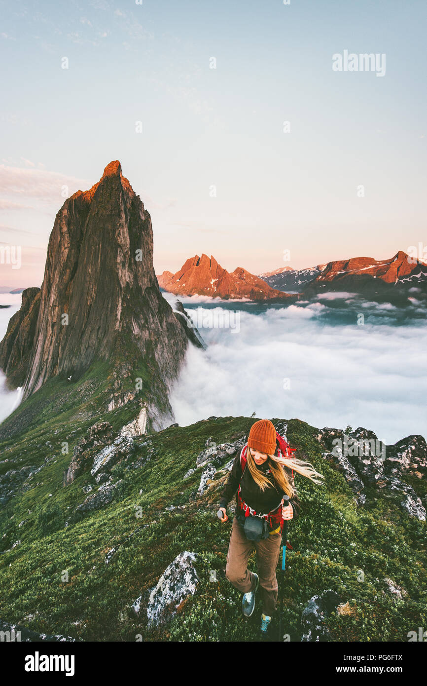 Active woman hiking on sunset Segla mountain adventure journey outdoor Norway vacations solo traveling lifestyle weekend getaway - Stock Image