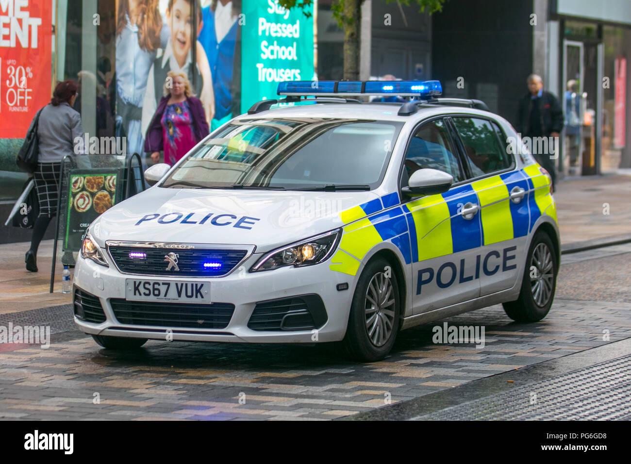 Police emergency response vehicle in Fishergate, Preston, UK Stock Photo