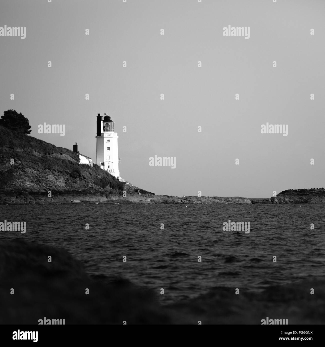St Anthony's lighthouse marking the eastern point of the entrance to Falmouth Harbour, in Cornwall, southern England, United Kingdom - Stock Image