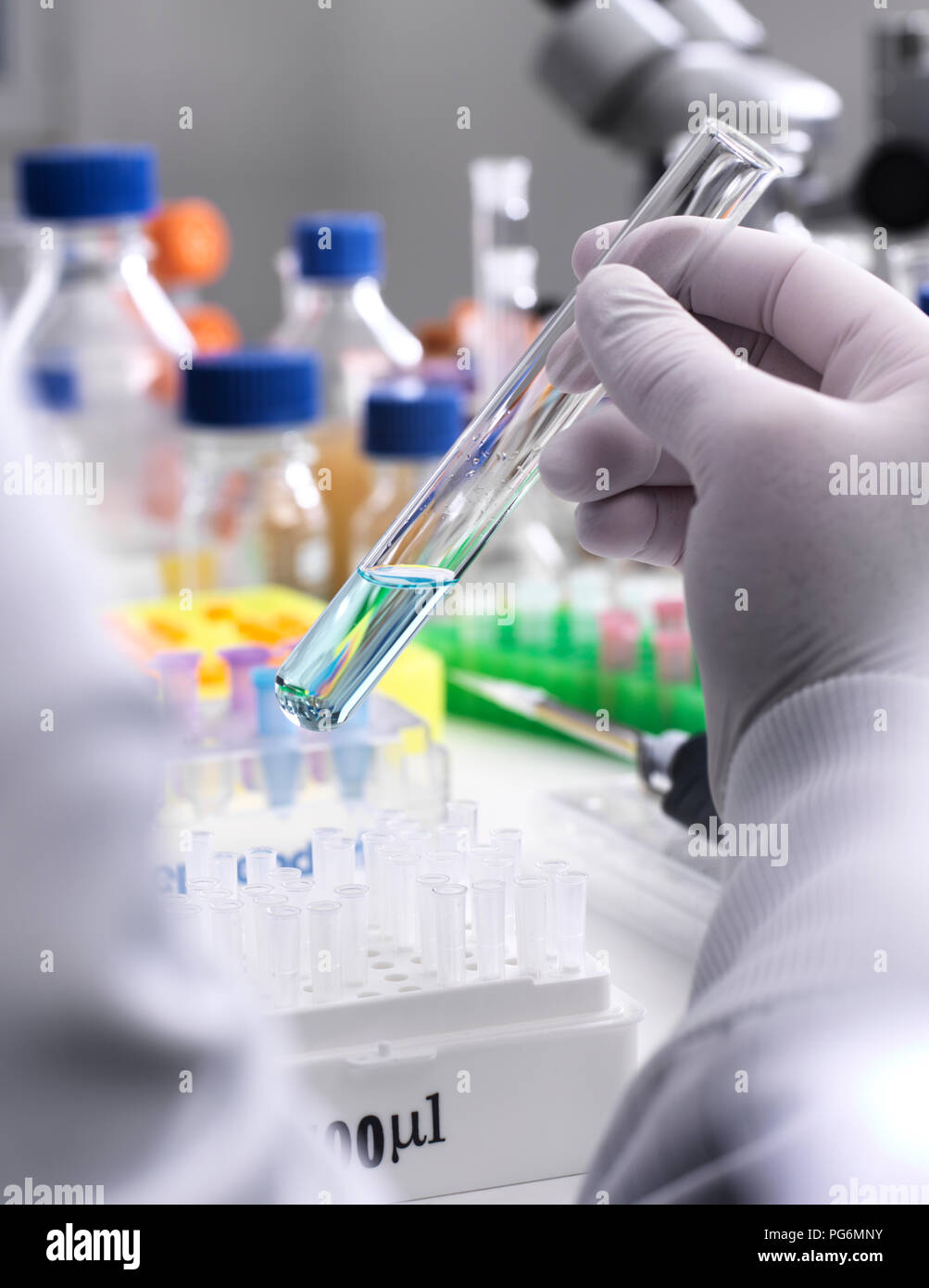 Research experiment, Scientist mixing a chemical formula in a test tube - Stock Image