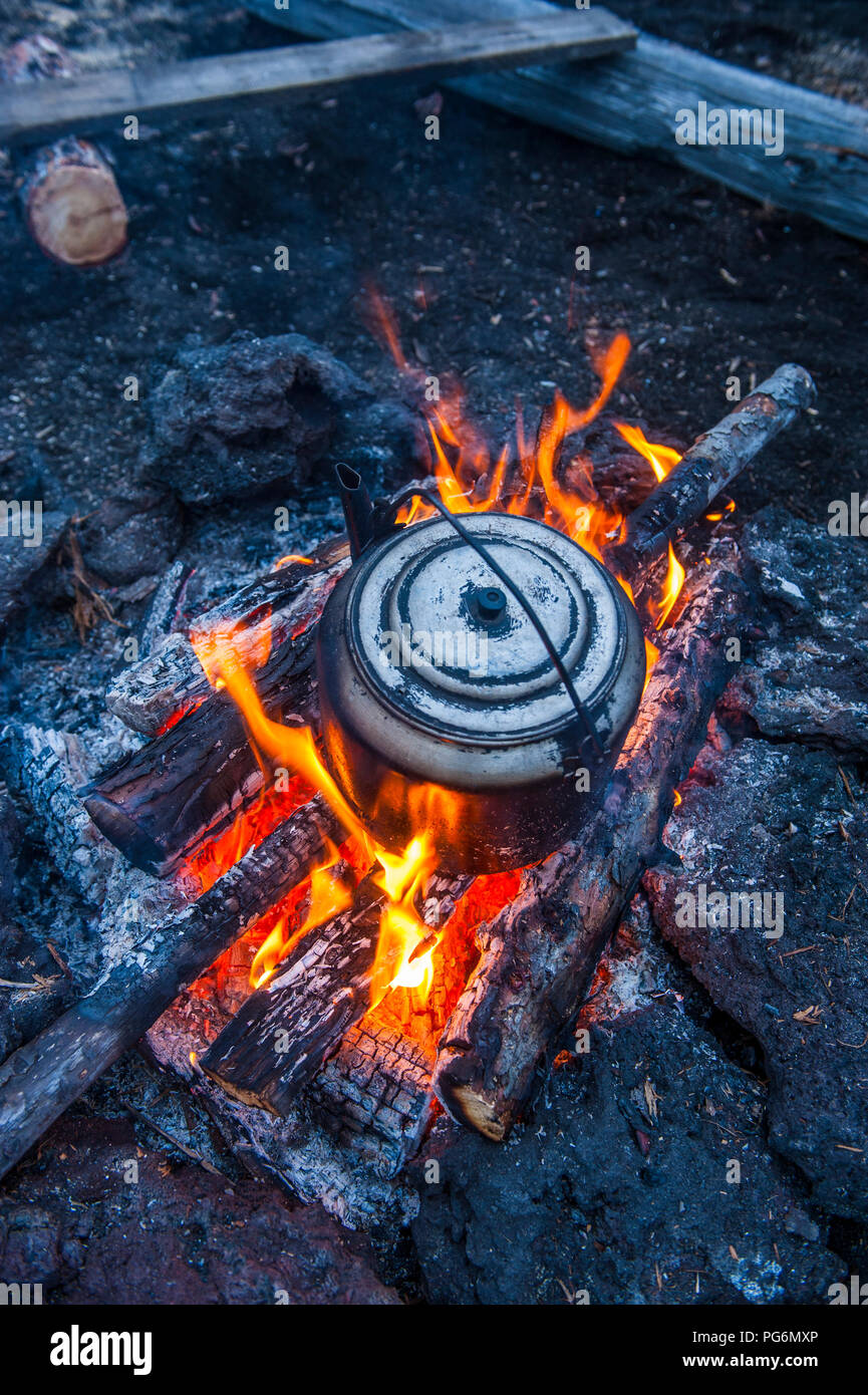 Boiling water pot over an open fire, Kamchatka, Russia - Stock Image