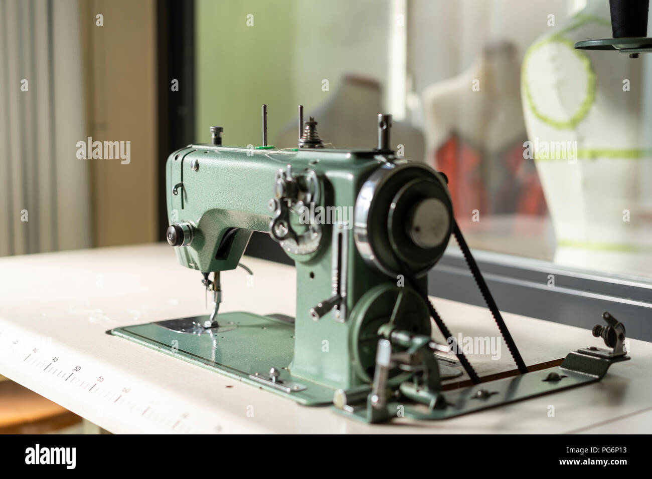 Sewing machine models in fashion designer's studio - Stock Image