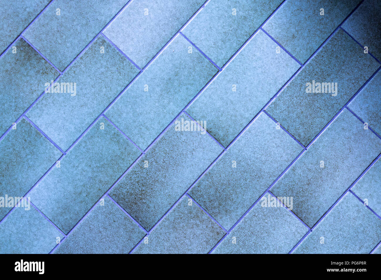 An abstract background of blue-green rectangular tiles - Stock Image