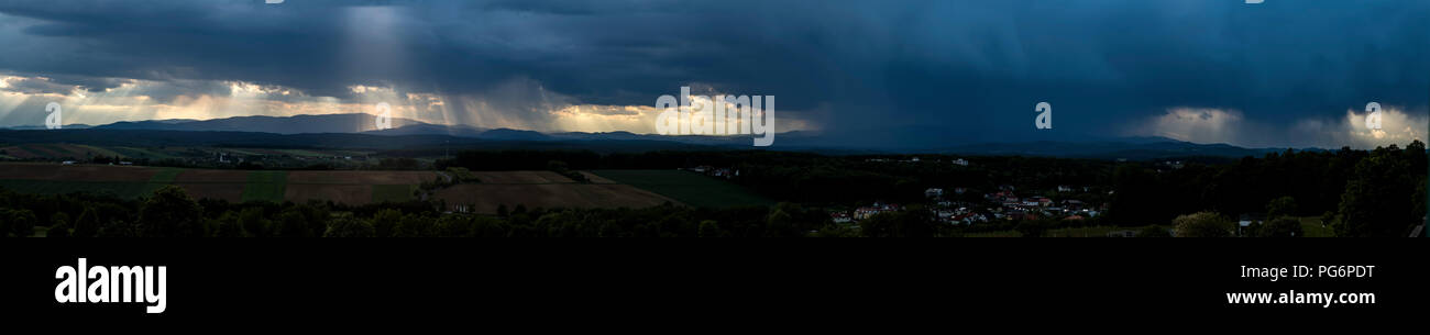 Germany, panoramic view, dark and dramatic cloudy mood during thunderstorm - Stock Image